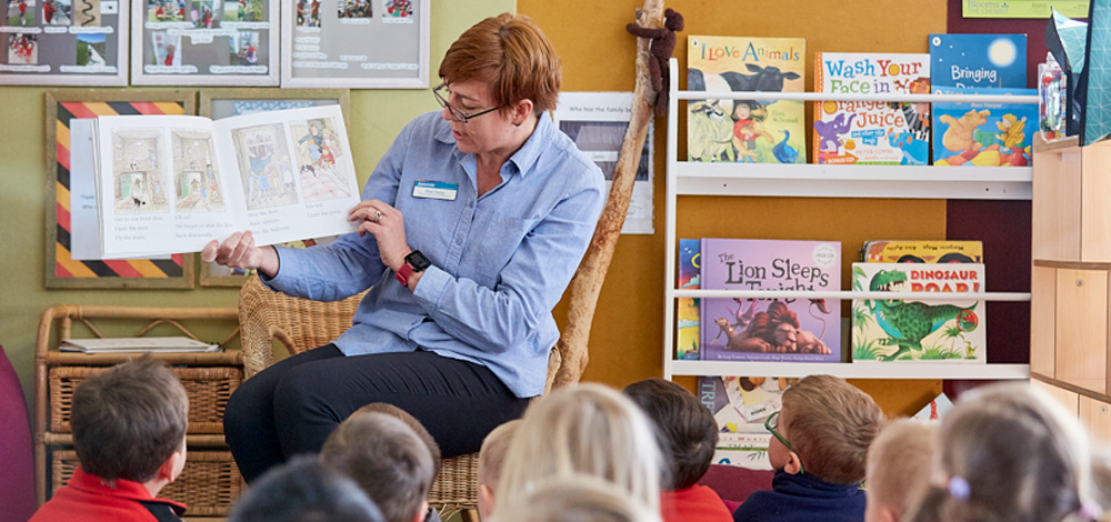 Image of teacher reading to students