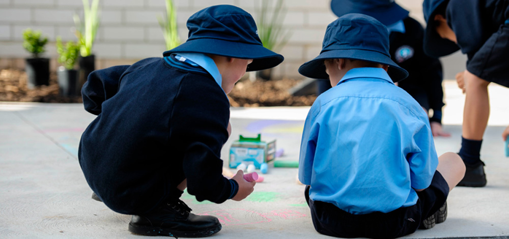 image of children drawing with chalk