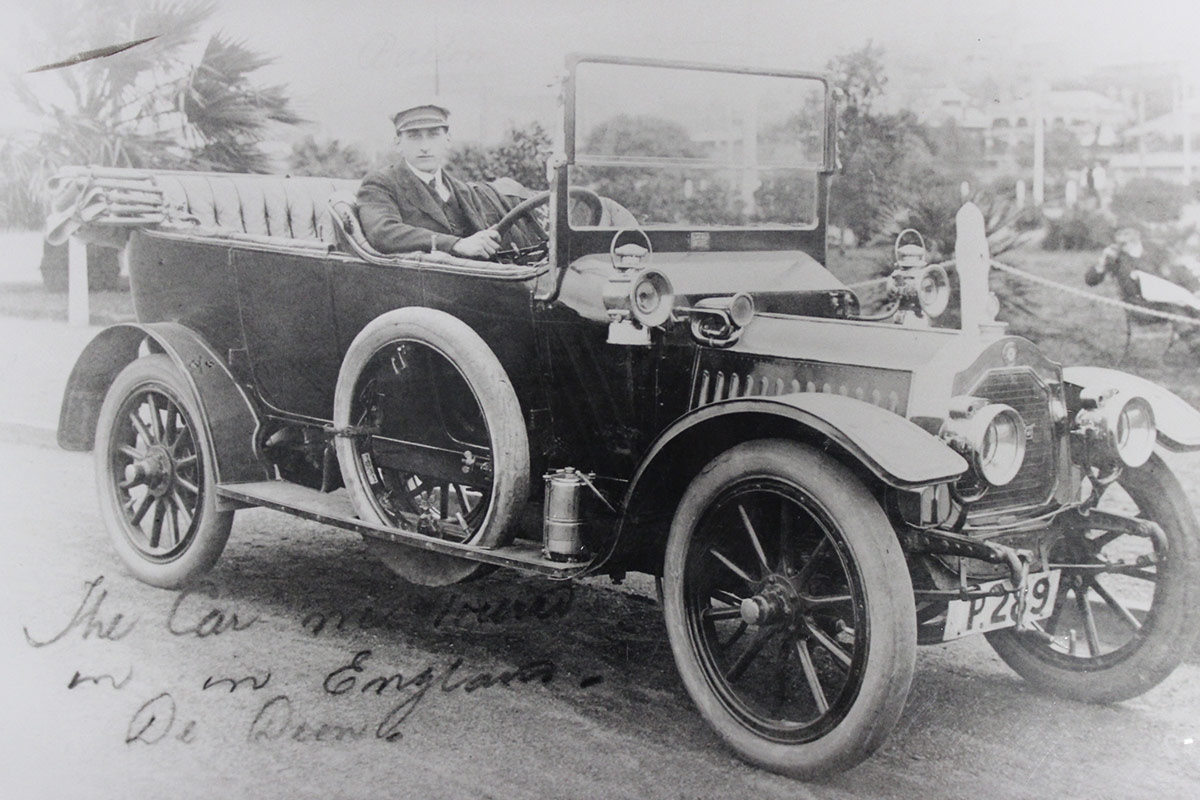 Chauffeur driving the De Dion car to transport would-be purchasers