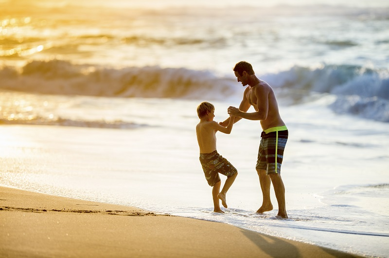 boy on beach with dad